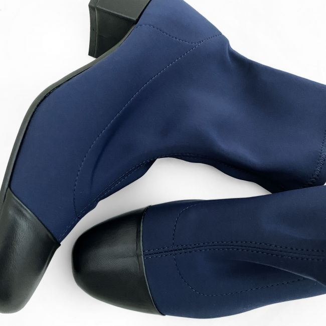 Blue sock ankle boots with black leather high heel and toe