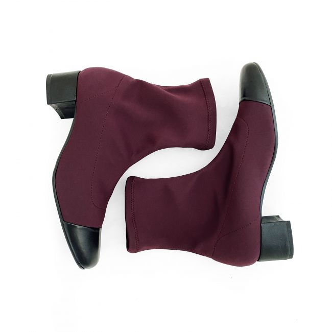 Burgundy sock ankle boots with black leather heel and toe