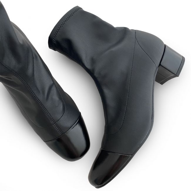 Black sock ankle boots with black leather toe