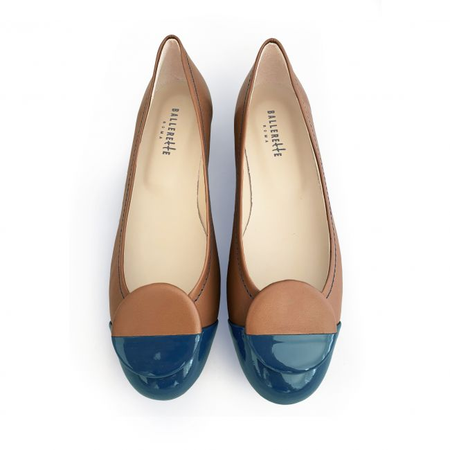 Tan leather ballet flats with blue patent toe and stud