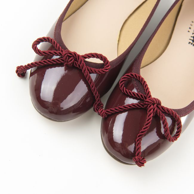 Burgundy patent leather ballet flats with bow