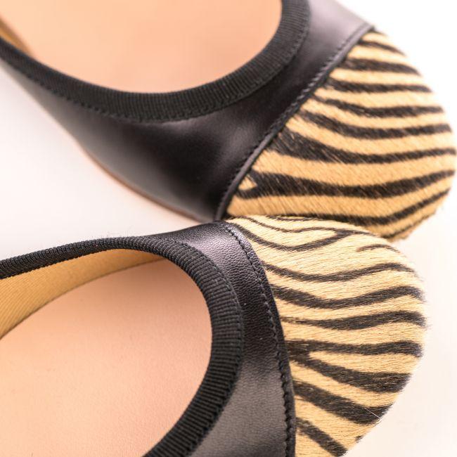 Black leather ballet flats with zebra pattern toe