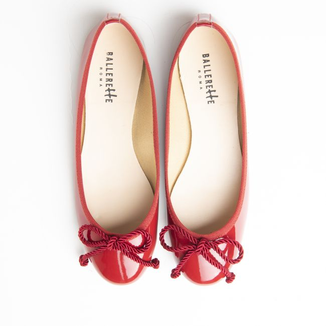 Red patent leather ballet flats with bow