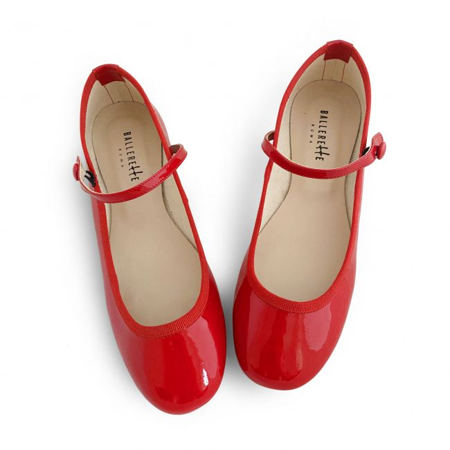 Red patent leather ballet flats with strap