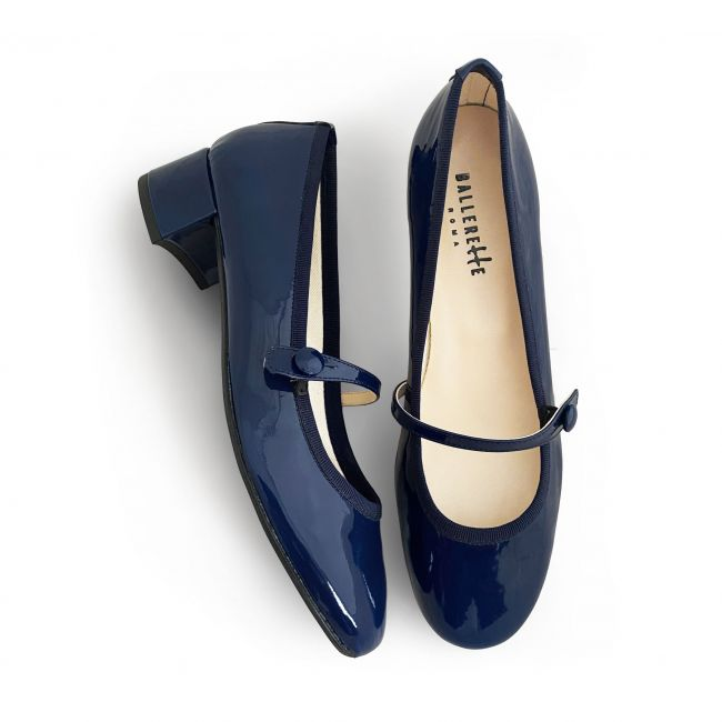 Blue patent leather ballet flats with strap and heel
