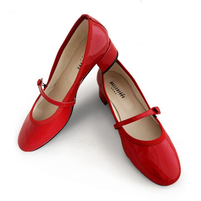 Red patent leather ballet flats with strap and heel