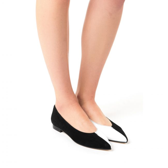 Pointed toe ballet flats in black and white leather and suede