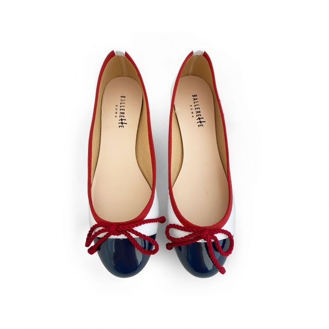 White leather ballet flats with blue patent toe and red ribbon